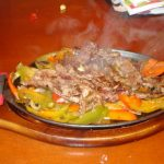 Sizzling Platter of Mexican Food from Nacho Mamas Marco Island FL